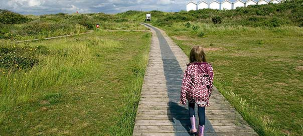 Girl walking at Dawlish Warren Nature reserve