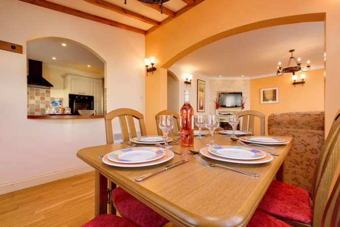 Dining area in Casita Lodge at Welcome Family Holiday Park