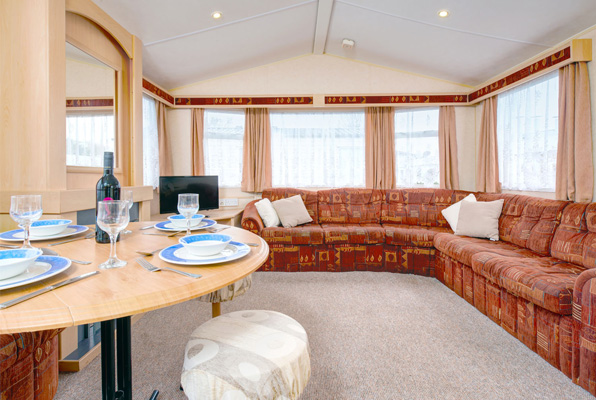 Living and dining room in Coral Reef - Silver Reef 3 Bedroom Classic Caravan