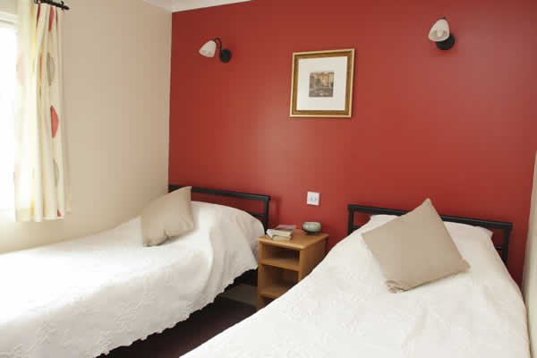 Full size single beds in lodge twin bedrooms