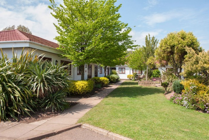 Trees and landscaped gardens in the Sandsurfer / Starsurfer Bungalow area at Welcome Family Holiday Park, Dawlish Warren, Devon