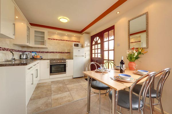 Dining area in Bungalows and Chalets at Welcome Family Holiday Park, Dawlish Warren, Devon