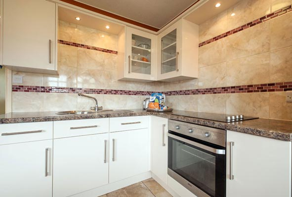 Kitchen in Bungalows and Chalets at Welcome Family Holiday Park, Dawlish Warren, Devon