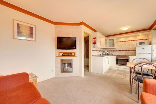 Open plan living room Bungalows and Chalets at Welcome Family Holiday Park, Dawlish Warren, Devon