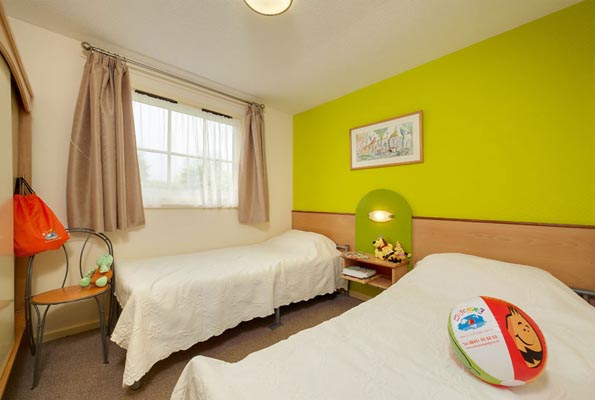 Twin Bedroom in Bungalows and Chalets at Welcome Family Holiday Park, Dawlish Warren, Devon