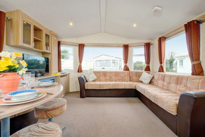 Seating area in Sunrise 2 bedroom caravan at Welcome Family Holiday Park
