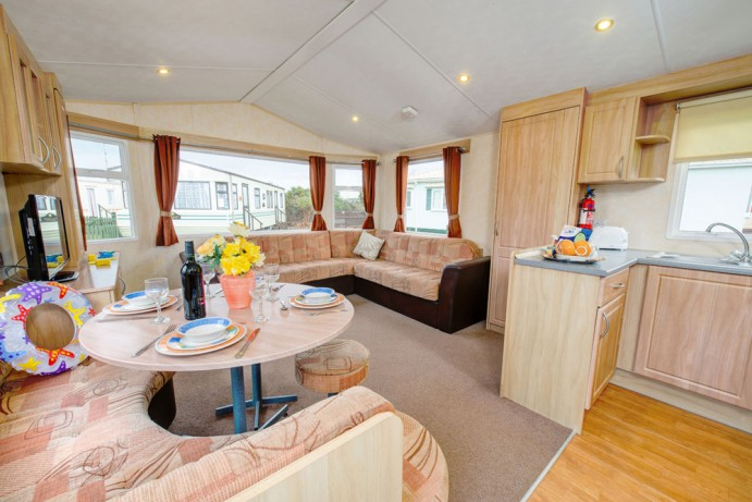 Lounge in Sunrise 2 bedroom caravan at Welcome Family Holiday Park