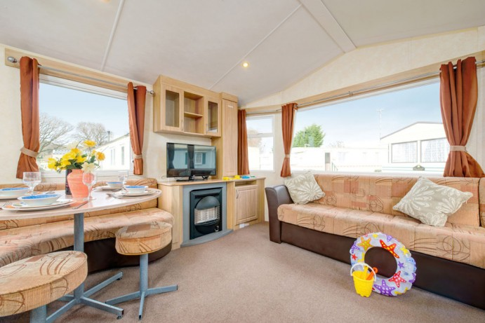 Living room in Sunrise 2 bedroom caravan at Welcome Family Holiday Park