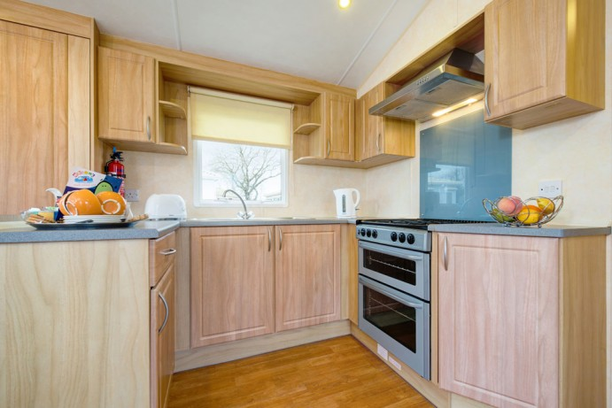 Kitchen in Sunrise Modern 2 bedroom caravan at Welcome Family Holiday Park