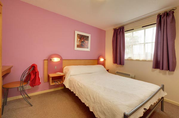 Master bedroom in Bungalows and Chalets at Welcome Family Holiday Park, Dawlish Warren, Devon