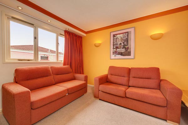Living Room in Bungalows and Chalets at Welcome Family Holiday Park, Dawlish Warren, Devon