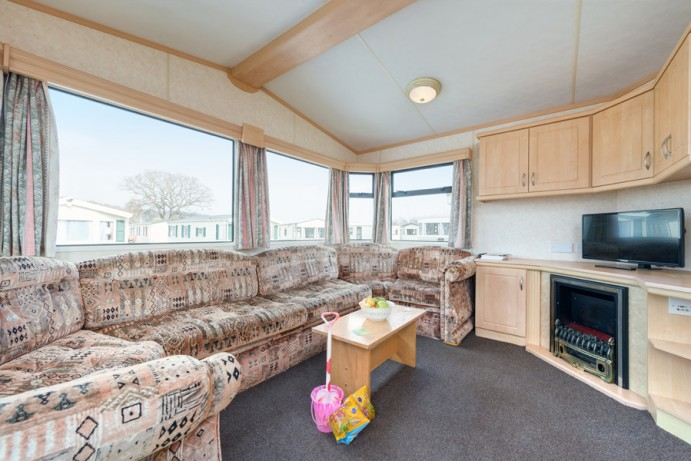 Typical Living area in Blue Reef 3 Bedroom Pet Friendly Caravan at Welcome Family