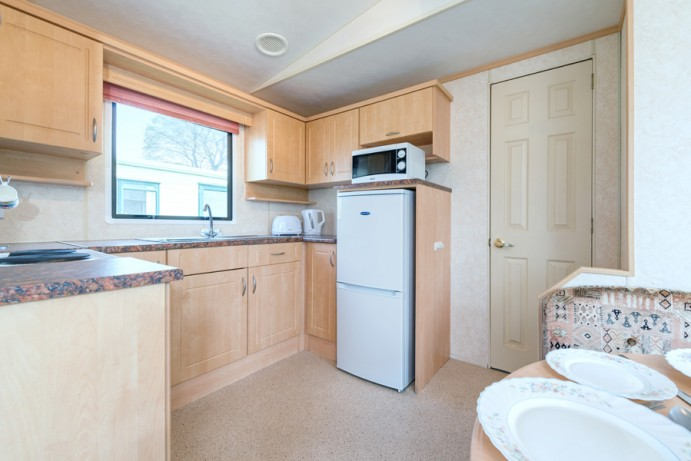 Kitchen in Blue Reef 3 Bedroom Pet Friendly Caravan at Welcome Family