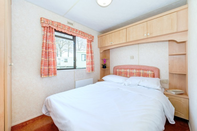 Master Bedroom in Blue Reef 3 Bedroom Pet Friendly Caravan at Welcome Family