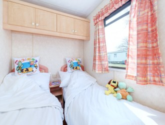 One of 2 twin bedrooms in the 3 Bedroom Caravan