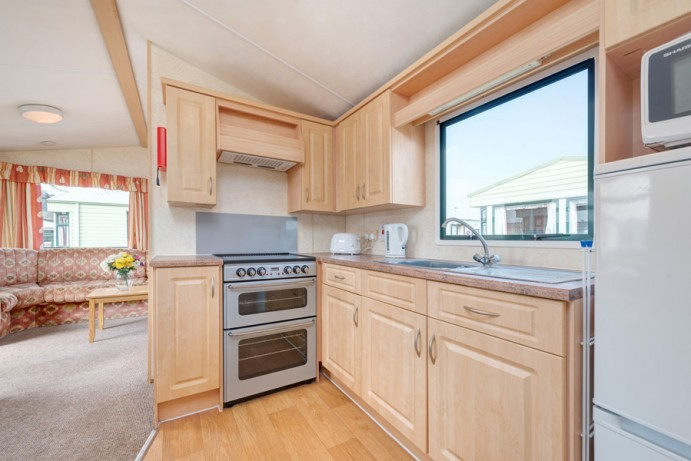 Kitchen in Sunset Dog Friendly 2 bedroom Holiday Caravans at Welcome Family Holiday Park
