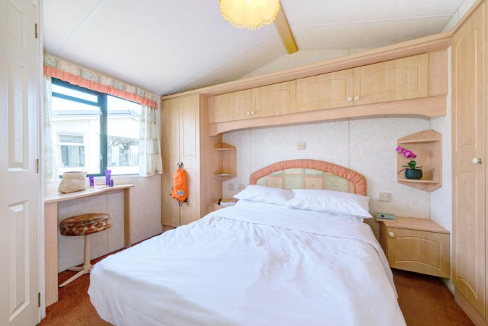 Full width master bedroom in Sunset Pet Friendly 2 bedroom Holiday Caravans at Welcome Family Holiday Park