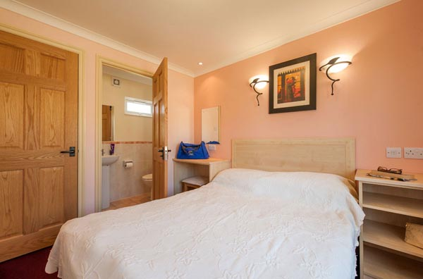 Master bedroom with en-suite in Casafina 3 Bedroom Lodge at Welcome Family Holiday Park