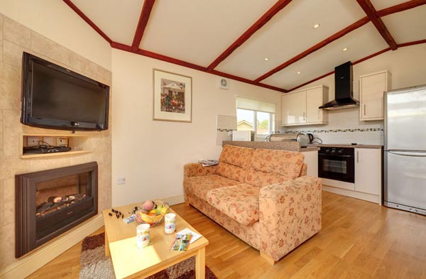 Open plan Lounge and Kitchen in Casafina 3 Bedroom Lodge at Welcome Family Holiday Park