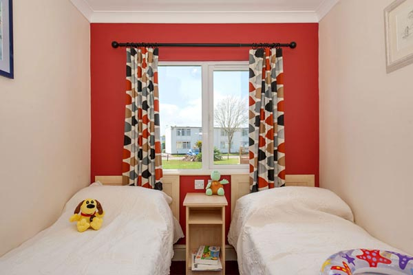 Kids bedroom with 2 single beds in Casafina 3 Bedroom Lodge at Welcome Family Holiday Park
