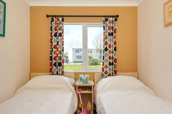Twin bedroom in Casafina 3 Bedroom Lodge at Welcome Family Holiday Park