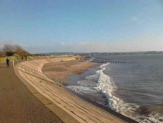 View of Dawlish Warren Beach at high tide.