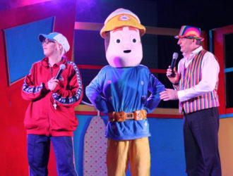 Mr Poodlebum on the Stage with Fireman character at Welcome Family Holiday Park