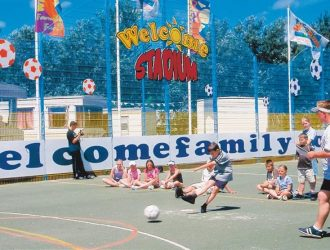 Kids playing football in the Sports ground at Welcome Family Holiday Park