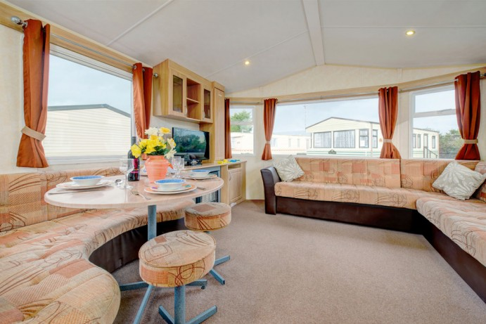 Living area of a classic caravan at Welcome Family Holiday Park