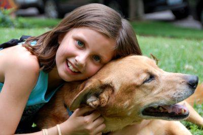 Girl cuddly a dog