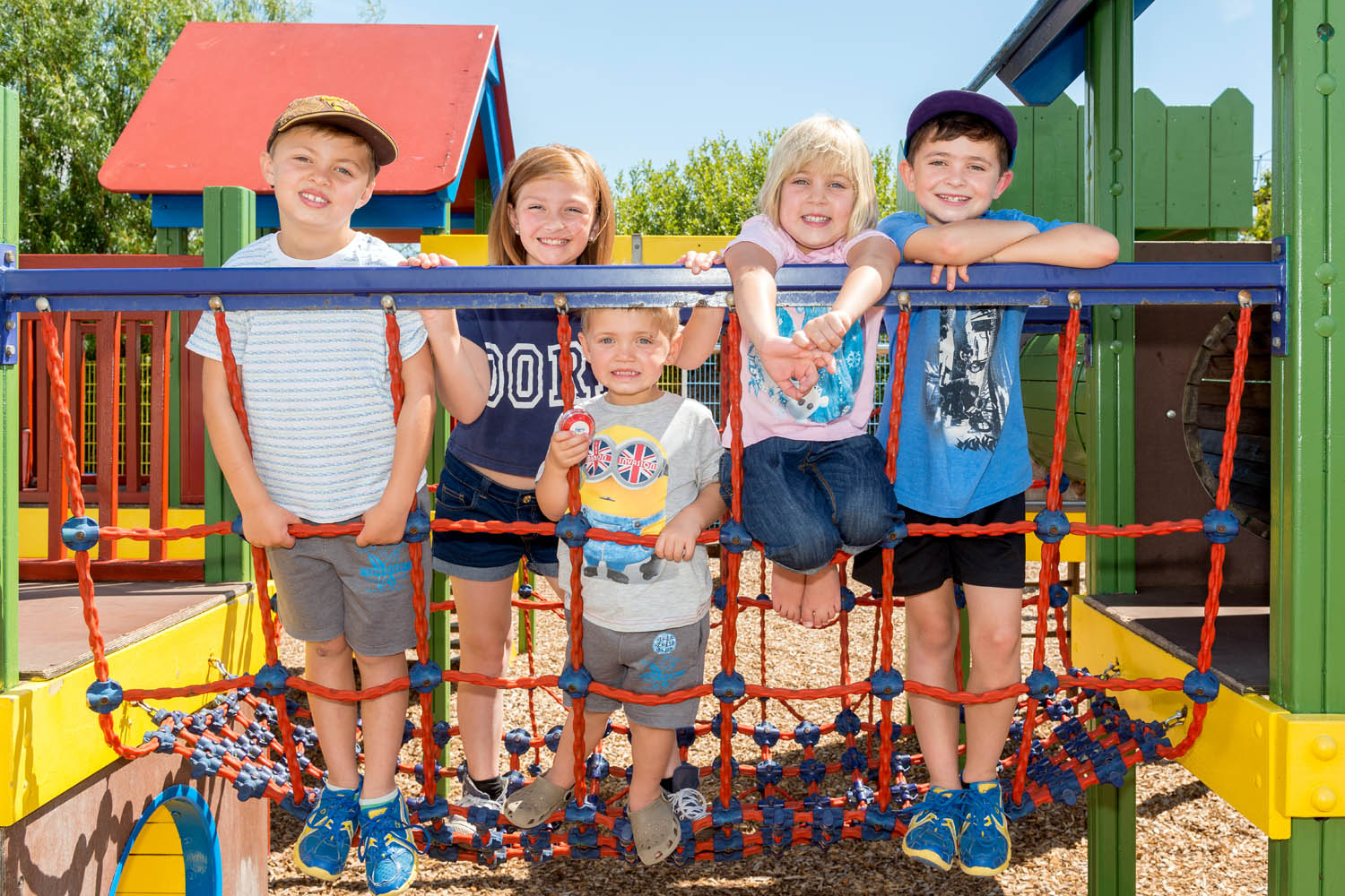 Children Posing for Picture on Climbing Frame