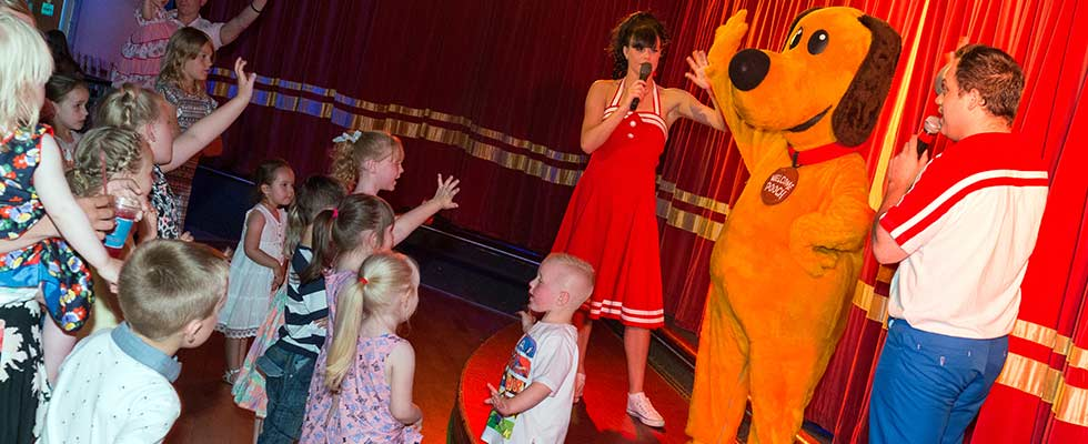 Dougie Dog and the entertainers on stage at Welcome family Holiday Park