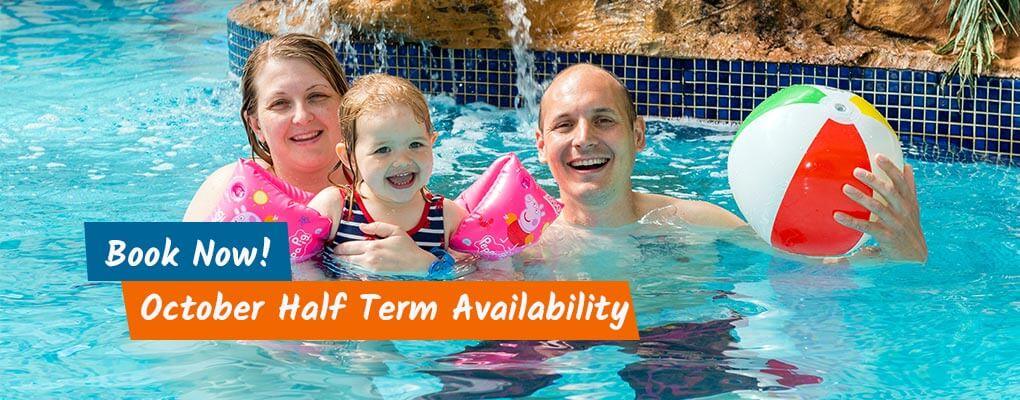Family having fun in the Swimming pools at Welcome Family Holiday park