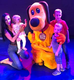 Kids with Dougy Dog mascot at Welcome Family Holiday park