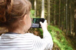 Child Taking Photo of Woodlands