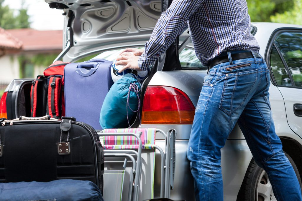 Man packing bags into the car