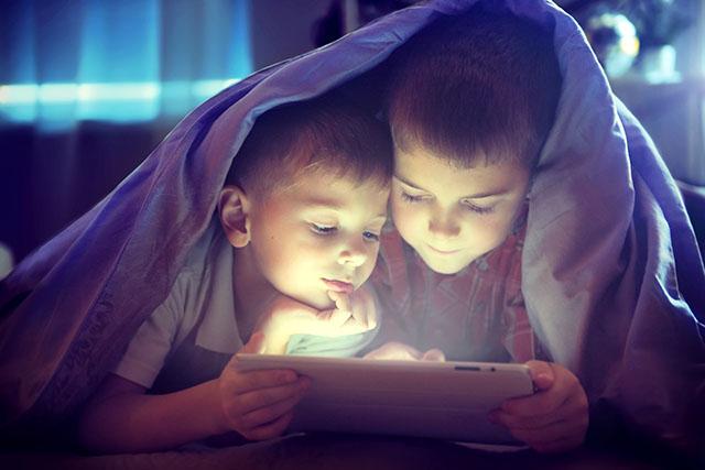 Kids hiding under blankets