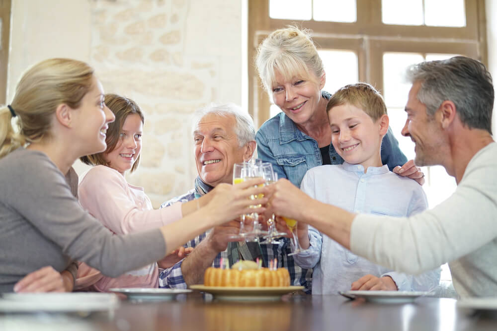 family celebrating grandfathers birthday