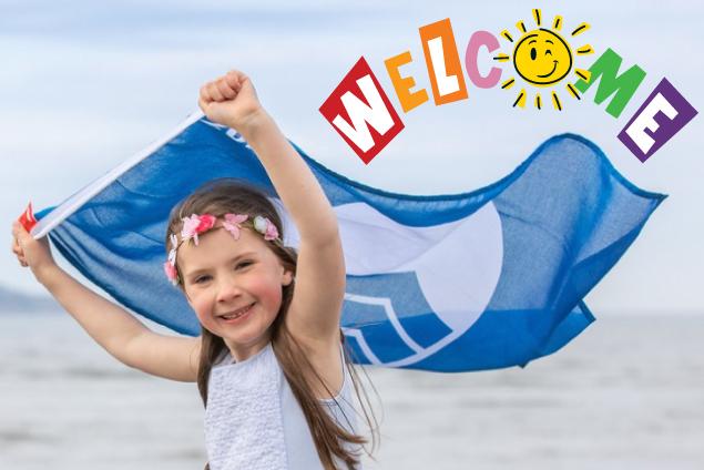 girl on beach with blue flag